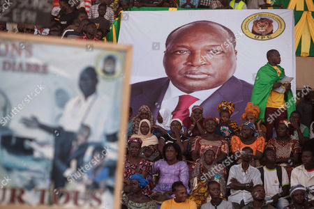 Zephirin Diabre On, people sit in front of a poster of Burkina Faso Zephirin Diabre from the UPC political party during a rally before elections to be held on Sunday in Ouagadougou, Burkina Faso. Last year, longtime strongman Blaise Compaore resigned amid protests that brought hundreds of thousands of Burkinabe into the streets, furious over the president's attempt to circumvent constitutional term limits and stay in office. The October 2014 uprising ushered in a transition that ends with presidential and legislative elections on Sunday, Nov. 29, 2015, the most hotly contested in the history of this West African nation