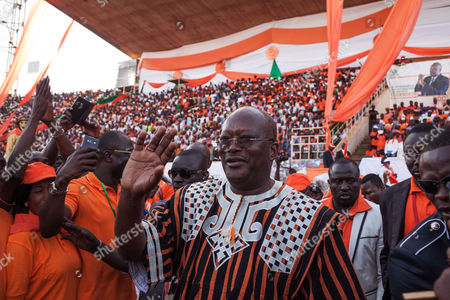 Burkina Faso presidential candidate Roch Marc Christian Kabore from the MPP party waves during a rally in Ouagadougou, Burkina Faso, . Last year, longtime strongman Blaise Compaore resigned amid protests that brought hundreds of thousands of Burkinabe into the streets, furious over the president's attempt to circumvent constitutional term limits and stay in office. The October 2014 uprising ushered in a transition that ends with presidential and legislative elections on Sunday, Nov. 29, 2015, the most hotly contested in the history of this West African nation