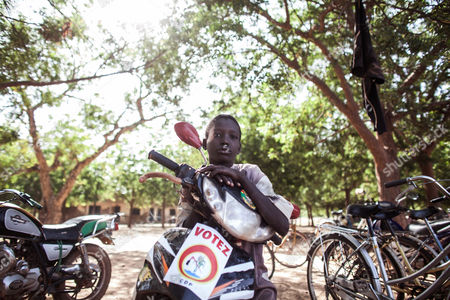 On, a child sits on a motorbike with a election poster on it in Ziniare, Burkina Faso. Last year, however, longtime strongman Blaise Compaore resigned amid protests that brought hundreds of thousands of Burkinabe into the streets, furious over the president's attempt to circumvent constitutional term limits and stay in office. The October 2014 uprising ushered in a transition that ends with presidential and legislative elections on Sunday, Nov. 29, 2015, the most hotly contested in the history of this West African nation