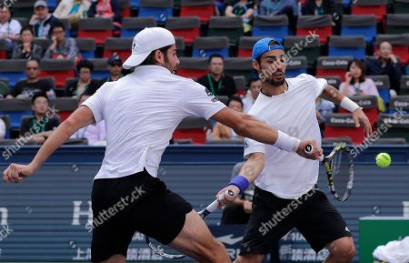 Simone Bolelli, left, and Fabio Fognini of Italy play their doubles final match against Marcelo Melo of Brazil and Raven Klaasen of South Africa in the Shanghai Masters tennis tournament at Qizhong Forest Sports City Tennis Center in Shanghai, China
