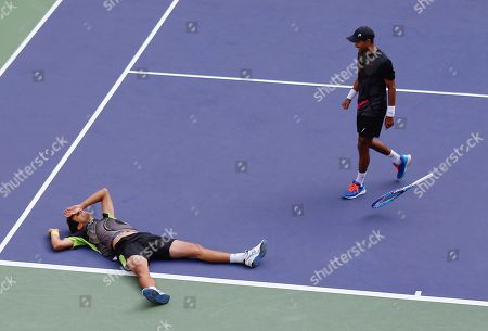 Marcelo Melo of Brazil, left, and Raven Klaasen of South Africa celebrates after defeating Simone Bolelli and Fabio Fognini of Italy in the doubles final match of the Shanghai Masters tennis tournament at Qizhong Forest Sports City Tennis Center in Shanghai, China