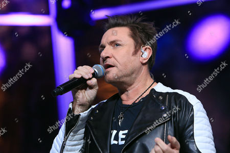 British songer Simon Le Bon performs during a 24-hour live webcast from the foot of the Eiffel Tower, in Paris, . Former U.S. Vice President Al Gore, who helped negotiate the 1997 climate treaty that failed to control global warming, will host the round-the-clock event that includes musical performances by Elton John, Duran Duran and others. Other concerts will be broadcast from locations around the globe, from Rio de Janeiro to Miami, Sydney and Cape Town