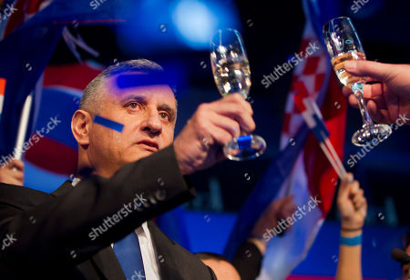 Tomislav Karamarko Opposition leader Tomislav Karamarko raises a glass as he celebrate his coalition's winning of majority of votes, in Zagreb, Croatia, early . Croatia's conservative opposition is leading in an official preliminary vote count against the ruling center-left coalition in the Balkan country's first parliamentary election since joining the European Union in 2013