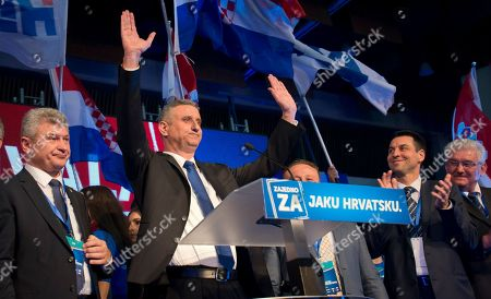 Stock Picture of Tomislav Karamarko Opposition leader Tomislav Karamarko, second from left, celebrates his coalition's winning of majority of votes, in Zagreb, Croatia, early . Croatia's conservative opposition is leading in an official preliminary vote count against the ruling center-left coalition in the Balkan country's first parliamentary election since joining the European Union in 2013