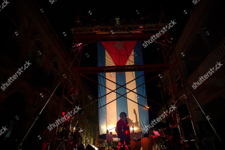 Silvio Rodriguez The shadow of singer and composer Silvio Rodriguez is cast on a Cuban national flag as he performs in a free concert in Old Havana, Cuba, . The musical event brought together two Cuban trovas, the new represented by Rodriguez, and the traditional represented by the Buena Vista Social Club, fronted by the charismatic Omara Portuondo