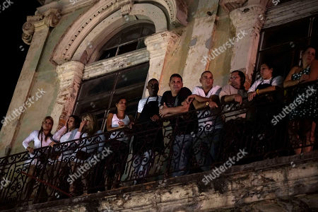 Omara Portuondo People watch from a balcony a free concert in Old Havana, Cuba, . The musical event brought together two Cuban trovas, the new represented by Silvio Rodriguez, and the traditional represented by the Buena Vista Social Club, fronted by the charismatic Omara Portuondo