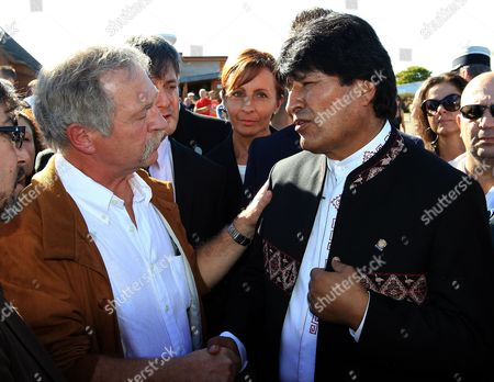 Bolivia's President Evo Morales, right, speaks with Green party and European Parliament member Jose Bove during an event, in Lescar, near Pau, southwestern France, . Morales is on a two day visit to France