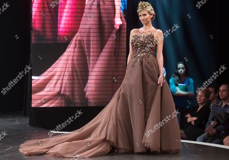 Former professional tennis player Tatiana Golovin presents a chocolate studded dress during a show as part of the chocolate fair in Paris