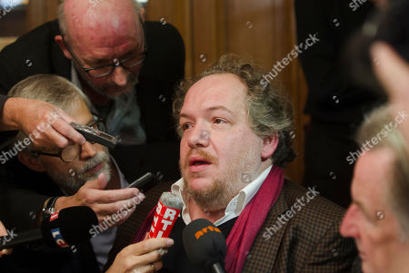 """French writer Mathias Enard, center, addresses reporters after being awarded with the 2015 Goncourt literary prize for his book """"Boussole"""" (Compass), in Paris, France, . As is traditional, the Prix Goncourt was announced at the Drouant restaurant in Paris"""