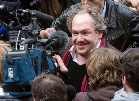 """French writer Mathias Enard makes his way as he arrives at the restaurant chez Drouant to receive the 2015 Goncourt literary prize for his book """"Boussole"""" (Compass), in Paris, France, . As is traditional, the Prix Goncourt was announced at the Drouant restaurant in Paris"""