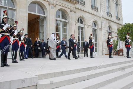 Kuwait's Prime Minister Sheikh Jaber Al-Mubarak Al-Hamad Al-Sabah, center left, leaves the Elysee Palace after his meeting with French President Francois Hollande, center right, in Paris, France