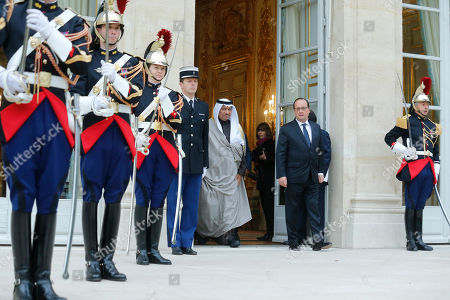 Kuwait's Prime Minister Sheikh Jaber Al-Mubarak Al-Hamad Al-Sabah, left, leaves the Elysee Palace in Paris, France, after his meeting with French President Francois Hollande, right