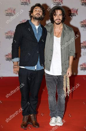 French singers Jeremy Frerot, left, and Florian Delavega of pop duo Frero Delavega arrive at the Cannes festival palace, to take part in the NRJ Music awards ceremony, in Cannes, southeastern France