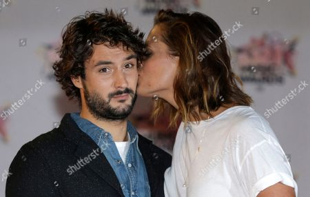 Stock Photo of Retired French 2004 Olympic, world and European champion swimmer, Laure Manaudou, right, poses with her boyfriend french singer Jeremy Frerot, of pop duo Frero Delavega at the Cannes festival palace, to take part in the NRJ Music awards ceremony, in Cannes, southeastern France