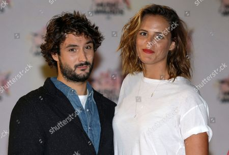 Retired French 2004 Olympic, world and European champion swimmer, Laure Manaudou, right, poses with her boyfriend french singer Jeremy Frerot, of pop duo Frero Delavega at the Cannes festival palace, to take part in the NRJ Music awards ceremony, in Cannes, southeastern France