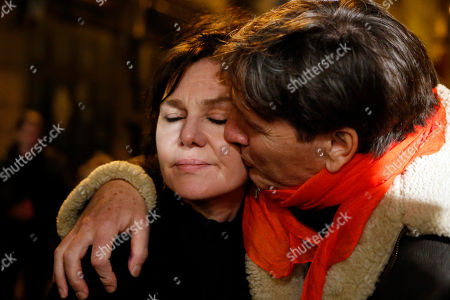 "British singer Lucy Dixon, living in Paris, left, is comforted after she sings a french song in front of ""The Petit Cambodge"" Restaurant, one of the sites of most deadly of six coordinated extremists attacks, in Paris, France, . French artists and cultural figures are calling for people to mark a week since the start of the Paris attacks with an outpouring of ""noise and light"