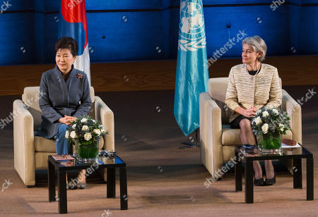 South Korea President Park Geun-hye, left, and UNESCO Director General Irina Bokova listen to South Korea's artist Sumi Jo performing on stage as part of the organization's 70th anniversary at it headquarters in Paris, France, Tuesday Dec, 1, 2015. President Park signed an agreement for the creation of an International Centre of Martial Arts for Youth Development and Engagement under the auspices of UNESCO in the city of Chungju
