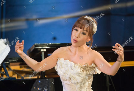 South Korea's artist Sumi Jo performs on stage as part of the UNESCO's 70th anniversary at it headquarters in Paris, France, Tuesday Dec, 1, 2015. South Korea's President Park signed an agreement for the creation of an International Centre of Martial Arts for Youth Development and Engagement under the auspices of UNESCO in the city of Chungju