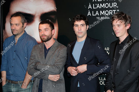 "From left, French actors Cedric Kahn, Guillaume Gouix,Tahar Rahim, and Swann Arlaud pose for photographers during the premiere of the movie ""Les Anarchistes"" (The Anarchists) directed by French director Elie Wajeman, in Paris, France"