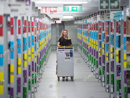 Employee Nancy-Lee Paulat works in the distribution center of the online retailer Amazon during a guided press tour prior to the upcoming Christmas business in Leipzig, central Germany, . Amazon has more than 285 million active customer accounts worldwide