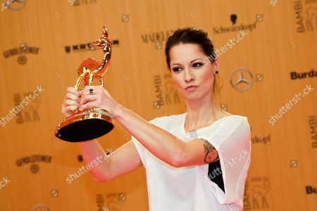 Stock Image of Austrian singer Christina Stuermer presents her 'Music National' Bambi 2015 media award during the awarding event in Berlin, . The Bambi awards are presented annually to recognize excellence in international media and television