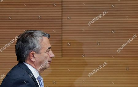 President of German soccer federation Wolfgang Niersbach leaves the room after announcing that he steps back from his post as president in Frankfurt, Germany