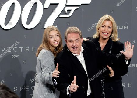 Comedian Oliver Kalkofe, center, his wife Connie, right, and daughter Celina, left, arrive for the German premiere of the James Bond movie 'Spectre' in Berlin, Germany