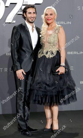 Natascha Ochsenknecht, right, and Umut Kekilli, left, arrive for the German premiere of the James Bond movie 'Spectre' in Berlin, Germany