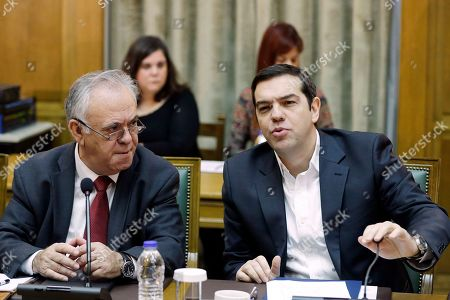 Alexis Tsipras Yannis Dragasakis Greece's Prime Minister Alexis Tsipras, right, speaks during a cabinet meeting as Deputy Prime Minister Yannis Dragasakis listens to him in Athens, . Greece failed to convince European creditors Monday to release vital bailout funds to shore up the country's public coffers and its crippled banks but hopes are high that a deal will be concluded within a week