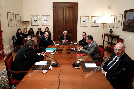 Greek President Prokopis Pavlopoulos, center, presides of a meeting of the Greek political party leaders, left to right, Panos Kammenos of the Independent Greeks, Fofi Gennimata of the PASOK, Alexis Tsipras of the Syriza, Giannis Plakiotakis of the New Democracy, Stavros Theodorakis of the Potami, and Vassilis Leventis of the Union of Centrists at the Presidential palace in Athens, . Tsipras called on the leaders of Greek opposition parties to hold an emergency meeting this weekend to seek consensus on the pension reform