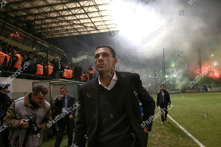 AEK Athens' coach Gus Poyet arrives at the pitch before the start of a Greek Super League soccer match against Panathinaikos at the Apostolos Nikolaides stadium in Athens