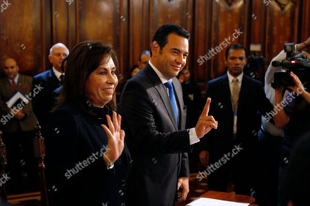 Jimmy Morales, Sandra Torres Presidential candidates, Sandra Torres, a former first lady, and Jimmy Morales, a comedian, pose for photos before signing a pact to respect governmental institutions during their meeting with current President President Alejandro Maldonado at the National Palace in Guatemala City, . Whoever wins the Oct. 25 presidential runoff will have to respond quickly to widespread demands for deep institutional reform in a country fed up with corrupt politics as usual
