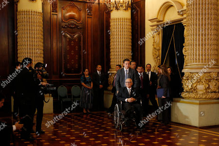 Stock Image of Alejandro Maldonado Guatemala's President President Alejandro Maldonado arrives in a wheelchair to the National Palace for a meeting with presidential candidates Jimmy Morales and Sandra Torres, ahead of a presidential election runoff in Guatemala City, . The massive protests that helped force President Otto Perez Molina and his vice president to resign this year amid a far-reaching customs-graft scandal have all but disappeared as Guatemala prepares to choose its next leader