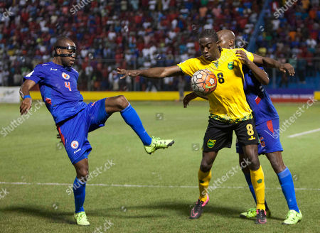 Clayton Donaldson, Kim Jaggy, Frantz Bertin Jamaica's Clayton Donaldson, center, fights for the ball against Haiti's Kim Jaggy, left, and Frantz Bertin, during a 2018 World Cup qualifying soccer match, in Port-au-Prince, Haiti