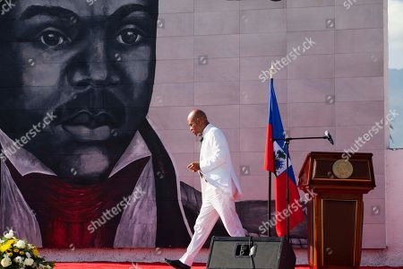 "Michel Martelly Haiti's President Michel Martelly returns to his seat after delivering a speech during a ceremony marking the 209th anniversary of the assassination of independence hero Gen. Jean-Jacques Dessalines, in Port-au-Prince, Haiti. The outgoing president released, a ong jeering at his critics, primarily an award-winning female journalist and human rights advocate. The released track called ""Bal Bannann Nan"", Haitian Creole for ""Give Them the Banana."" It's credited to Sweet Micky, the stage name for Haiti's pop-star-turned-president"