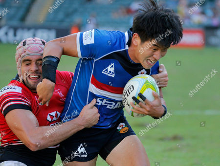 Stock Picture of Christopher Russell Maize, Lee Seok Gyun South Korea's Lee Seok-gyun, right, is tackled by Hong Kong's Christopher Russell Maize during the match against at the Asia Rugby Sevens qualifier for the 2016 Rio Olympics in Hong Kong, . Hong Kong won 19-10