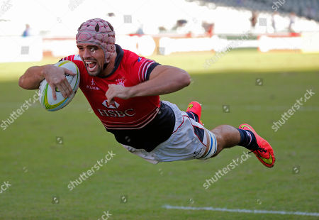 Christopher Russell Maize Hong Kong's Christopher Russell Maize dives in to score a try during the match against South Korea at the Asia Rugby Sevens qualifier for the 2016 Rio Olympics in Hong Kong, . Hong Kong won 19-10