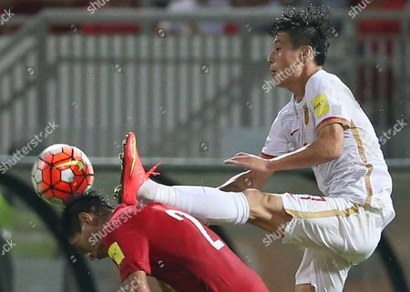 Lee Chi Ho, Wu Lei Hong Kong's Lee Chi Ho, left, is challenged by China's Wu Lei during the 2018 World Cup Asian qualifying match in Hong Kong
