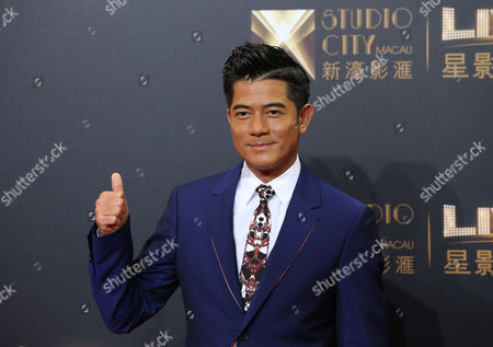 "Stock Image of Aaron Kwok Hong Kong actor-singer Aaron Kwok poses on the red carpet of the opening ceremony for the Studio City project in Macau. A leading 13 nominations went to ""Port of Call,"" a thriller about a detective looking into a heinous crime that tore apart two families and is loosely based on a real Hong Kong crime at the Hong Kong Film Awards. It's up for best film, best actor for Hong Kong superstar Aaron Kwok and best director for Philip Yung, for whom ""Port of Call"" was his third feature"