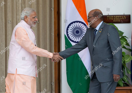 Omar Hassan Ahmad al-Bashir, Narendra Modi Sudan's President Omar Hassan Ahmad al-Bashir, right, shakes hands with India's Prime Minister Narendra Modi as he arrives for a bilateral meeting on the sidelines of the India Africa Forum Summit in New Delhi, India, . Modi on Thursday described India and Africa as bright spots of hope and economic opportunity and offered technology and credit to match rival China at a summit with more than 40 African leaders