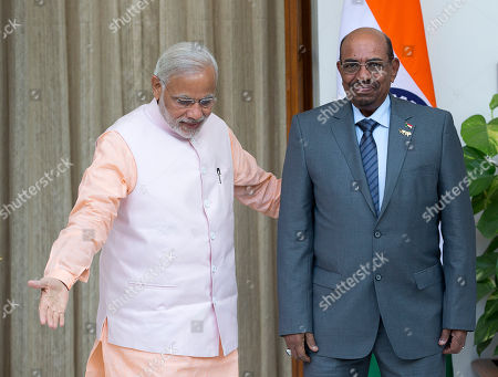Omar Hassan Ahmad al-Bashir, Narendra Modi India's Prime Minister Narendra Modi, left, welcomes Sudan's President Omar Hassan Ahmad al-Bashir as they arrive for a bilateral meeting on the sidelines of the India Africa Forum Summit in New Delhi, India, . Modi on Thursday described India and Africa as bright spots of hope and economic opportunity and offered technology and credit to match rival China at a summit with more than 40 African leaders