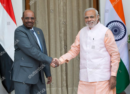 Omar Hassan Ahmad al-Bashir, Narendra Modi Sudan's President Omar Hassan Ahmad al-Bashir, left, shakes hands with India's Prime Minister Narendra Modi as they pose for photographs before a bilateral meeting on the sidelines of the India Africa Forum Summit in New Delhi, India, . Modi on Thursday described India and Africa as bright spots of hope and economic opportunity and offered technology and credit to match rival China at a summit with more than 40 African leaders
