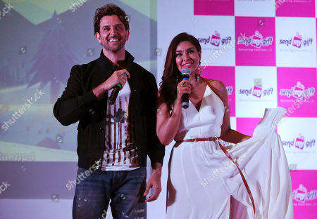 Hrithik Roshan, Lisa Ray Bollywood actor Hrithik Roshan, left, and actress Lisa Ray interact with journalists during a promotional event for an e-commerce marketplace for gifting in Bangalore, India