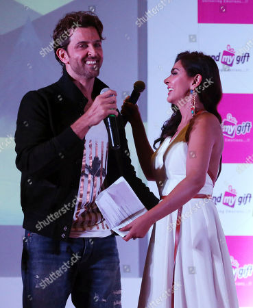 Hrithik Roshan, Lisa Ray Bollywood actor Hrithik Roshan, left, and actress Lisa Ray prepare to hug each other during a promotional event for an e-commerce marketplace for gifting in Bangalore, India