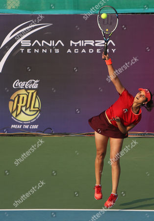 Sania Mirza, Leander Paes Indian tennis players Sania Mirza plays a shot during an exhibition mixed doubles match against Martina Navratilova and Mahesh Bhupathi at Sania Mirza Tennis Academy in the outskirts of Hyderabad, India, . Mirza teamed up with Leander Paes in the match that was held to promote International Premier Tennis League (IPTL