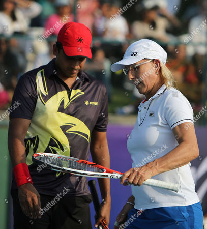 Martina Navratilova Tennis legend Martina Navratilova speaks with her partner Mahesh Bhupathi during an exhibition mixed doubles match against Sania Mirza and Leander Paes at Sania Mirza Tennis Academy in the outskirts of Hyderabad, India, . The match was held to promote International Premier Tennis League (IPTL