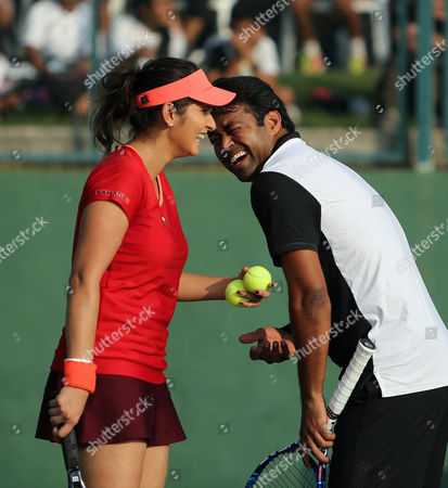 Sania Mirza, Mahesh Bhupathi Indian tennis players Sania Mirza, left, and Leander Paes laugh during an exhibition mixed doubles match against Martina Navratilova and Mahesh Bhupathi at Sania Mirza Tennis Academy in the outskirts of Hyderabad, India, . The match was held to promote International Premier Tennis League (IPTL