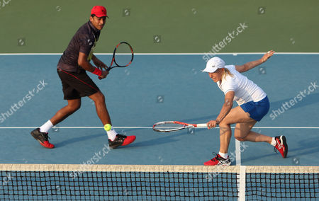 Martina Navratilova Tennis legend Martina Navratilova plays a shot with her partner Mahesh Bhupathi looking on during an exhibition mixed doubles match against Sania Mirza and Leander Paes at Sania Mirza Tennis Academy in the outskirts of Hyderabad, India, . The match was held to promote International Premier Tennis League (IPTL