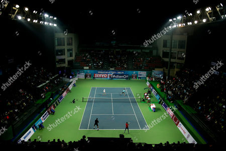 Indian tennis player Leander Paes plays a shot with his partner Tennis legend Martina Navratilova looking on during an exhibition mixed doubles match against Sania Mirza and Mahesh Bhupathi in New Delhi, India