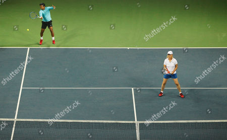 Leander Paes, Martina Navratilova Indian tennis player Leander Paes returns a serve as his partner Martina Navratilova looks on during an exhibition mixed doubles match against Sania Mirza and Mahesh Bhupathi to promote International Premier Tennis League (IPTL) in New Delhi, India